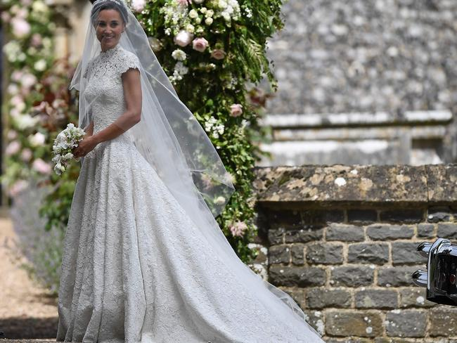Pippa Middleton, sister of Britain's Catherine, Duchess of Cambridge, arrives for her wedding to James Matthews at St Mark's Church in Englefield in a Giles Deacon designer dress. Picture: AFP