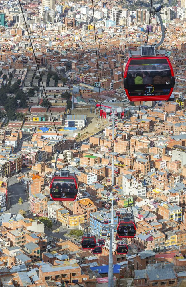 Cable cars carry passengers between the cities of El Alto and La Paz in Bolivia.