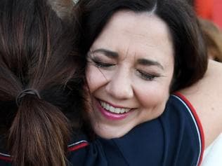 Queensland Premier Annastacia Palaszczuk hugs a a nursing staff member outside the Gold Coast University Hospital, Friday, November 24, 2017. Ms Palaszczuk is on the campaign trail ahead of tomorrow's state election. (AAP Image/Dan Peled) NO ARCHIVING