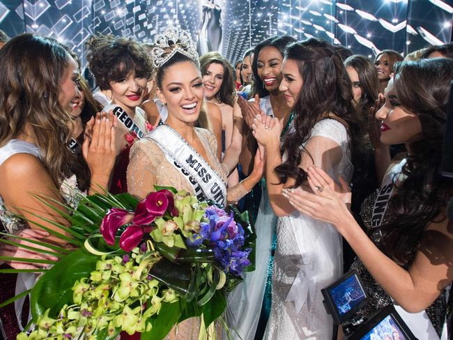 Demi-Leigh Nel-Peters, Miss South Africa 2017 is congratulated by fellow contestants after being crowned Miss Universe. Picture: AFP