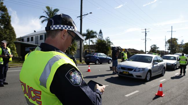 Crackdown ... Rapid Action Police officers during carry out a drug and alcohol test in Palm Beach, Gold Coast. Picture: Regi Varghese