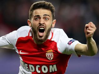 (FILES) A file photo taken on March 15, 2017 at the Stade Louis II in Monaco shows Monaco's Portuguese midfielder Bernardo Silva celebrating after his team scored a goal during the UEFA Champions League football match Monaco and Manchester City. Portuguese playmaker Bernardo Silva is to join Manchester City from French champions Monaco on July 1, 2017 the English Premier League club announced on May 26, 2017. / AFP PHOTO / Valery HACHE