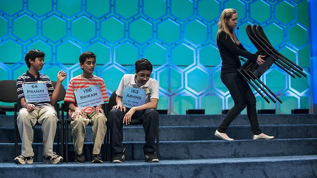 The final three competitors, Pranav Sivakumar (from left), Sriram J. Hathwar and Arvind V. Mahankali during the championship round at the Scripps National Spelling Bee. AFP PHOTO/Brendan SMIALOWSKI