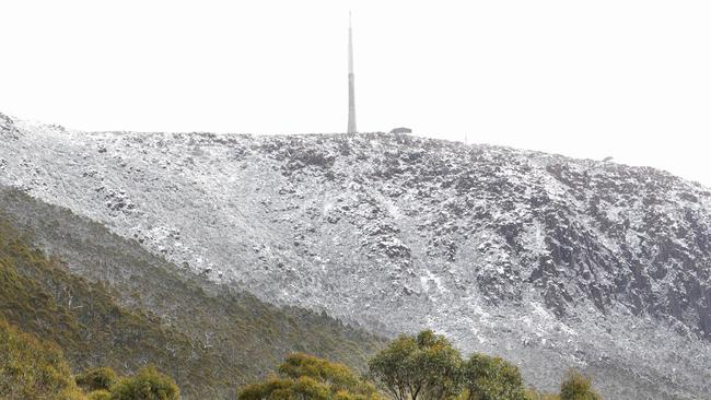 Snow covered Mt Wellington/Kunanyi which towers over Hobart on the weekend. Picture: Patrick Gee