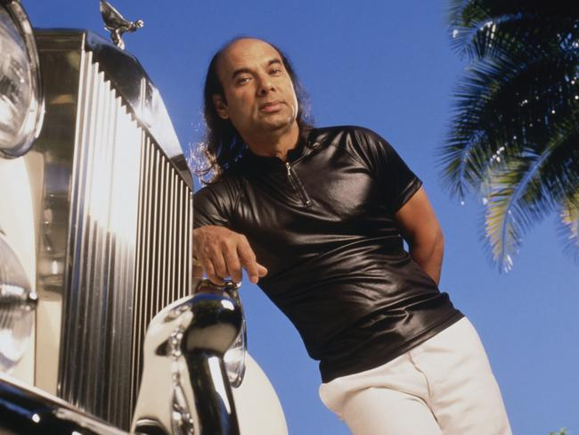 Rich ... Bikram Choudhury, who started Bikram yoga, with his Rolls Royce. Picture: Supplied