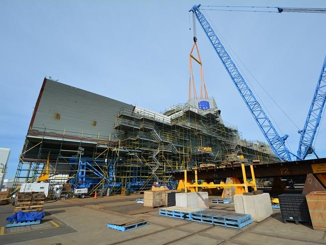 The main radar tower for one of the Air Warfare Destroyers, the Hobart, is lifted into position. Picture: Department of Defence