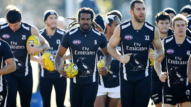 Harry O'Brien leads out his teammates at training this morning. Picture: Michael Klein