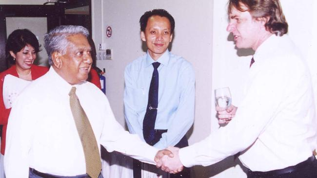 Dr John Tholen, right, with former Singaporean President S. R. Nathan.