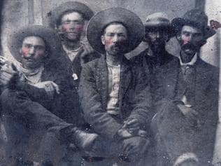 This photo provided by Frank Abrams shows what historians believe is a photo of outlaw Billy the Kid, second from left, and Pat Garrett, far right, taken in 1880. Frank Abrams, who bought the photo at a flea market says experts in forensics and facial recognition have verified the picture after several months of examination. (Courtesy of Frank Abrams via AP)
