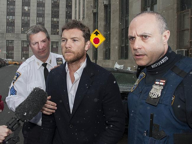 Worthington arrives at a New York court today, accused of assaulting snapper Li. Picture: Splash