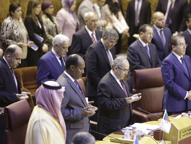 Mourning the dead ... Arab foreign ministers take part in a minute of silence for victims of the ongoing Israeli-Palestinian conflict in Gaza during an Arab foreign ministers' meeting at the Arab League headquarters in Cairo, Egypt, last night.