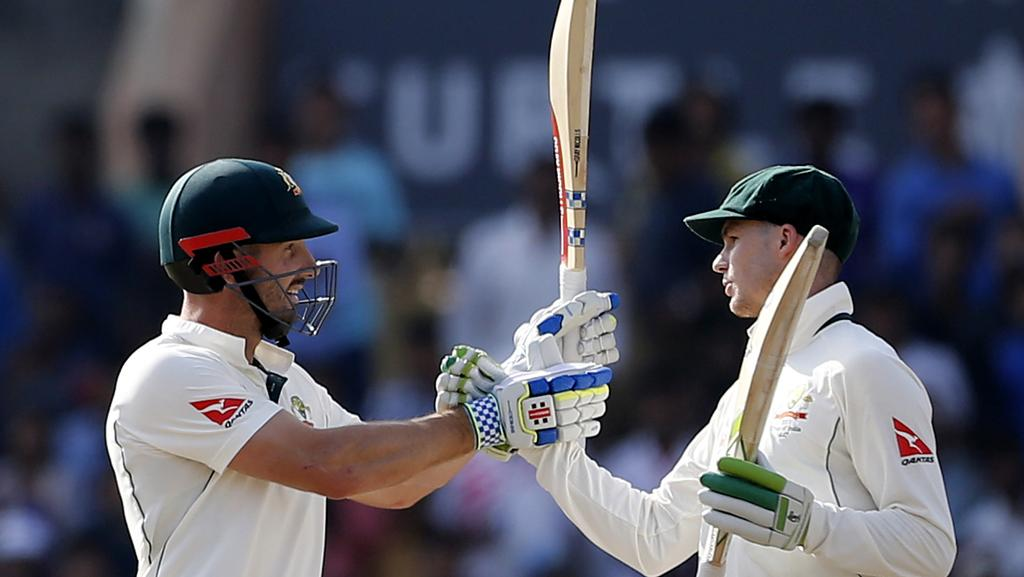 Shaun Marsh, left, celebrates his 50 with teammate Peter Handscomb.