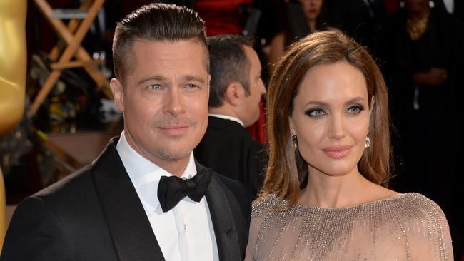 Loved up ... Hollywood stars Brad Pitt and Angelina Jolie have wed in a private ceremony in France. Picture: Getty Images