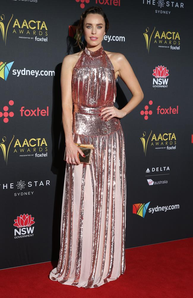 Jessica McNamee poses for photographers at the AACTAs.