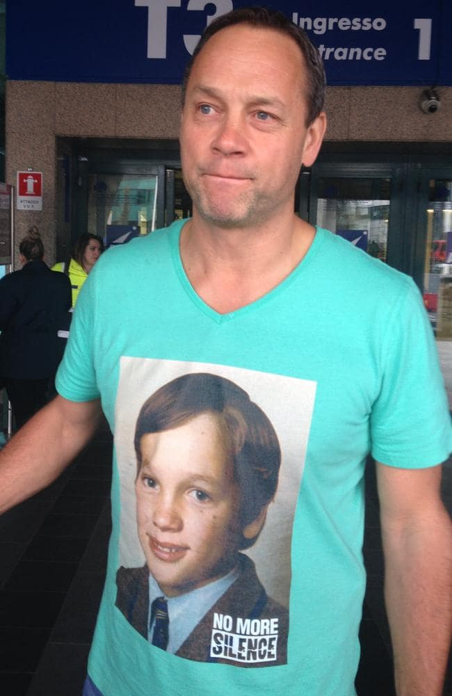 Peter Blenkin arrives in Rome wearing a T-shirt with an image of himself as a boy. Picture: Charles Miranda