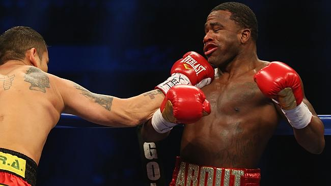 Marcos Maidana catches Adrien Broner with a right hand to force the American back onto the ropes.