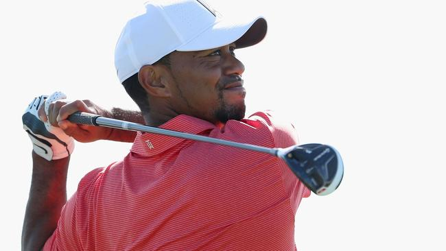 Tiger Woods hits a tee shot ahead of the Hero World Challenge.