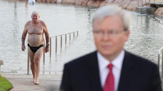Kevin Rudd tries Tony Abbott's old move of getting a photo with budgie smugglers. It does not work out. Picture: Lyndon Mechielsen