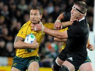 Wallabies Quade Cooper (L) is tackled All Blacks Brad Thorn during New Zealand v Australia 2011 Rugby World Cup (RWC) semi-final match at Eden Park Stadium in Auckland, 16/10/2011.