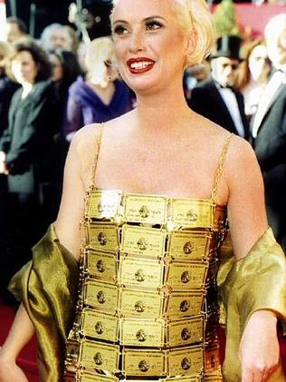 Australian costume designer Lizzy Gardiner wearing dress made out of American Express gold credit cards at the Academy Awards 27 Mar 1995.