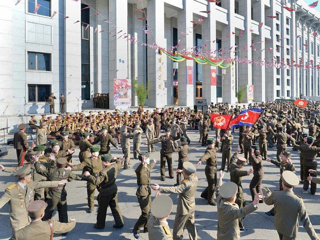North Korean soldiers dancing after casting their votes in the election of deputies to th