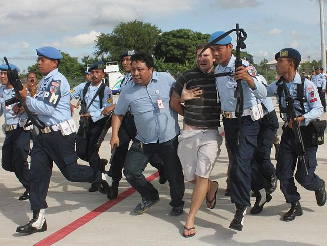 Runway chaos ... Matt Christopher Lockley being arrested by Indonesian air force soldiers after landing on the Virgin Australia 737-800 plane at Ngurah Rai airport in Denpasar.