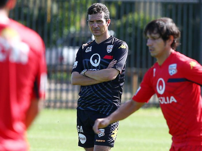 Adelaide United coach Guillermo Amor keeps a close eye on training.
