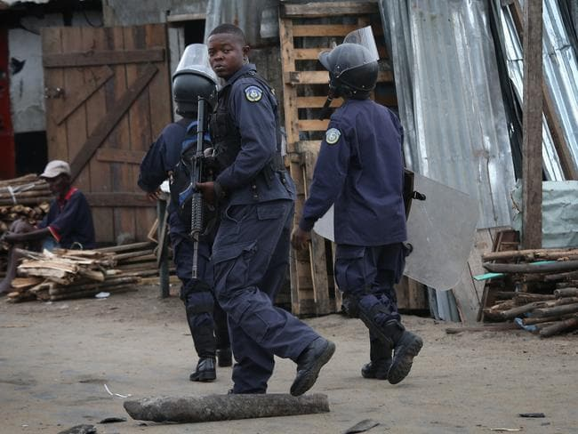 Police response ... cops depart after firing shots in the air while trying to protect an Ebola burial team in West Point.