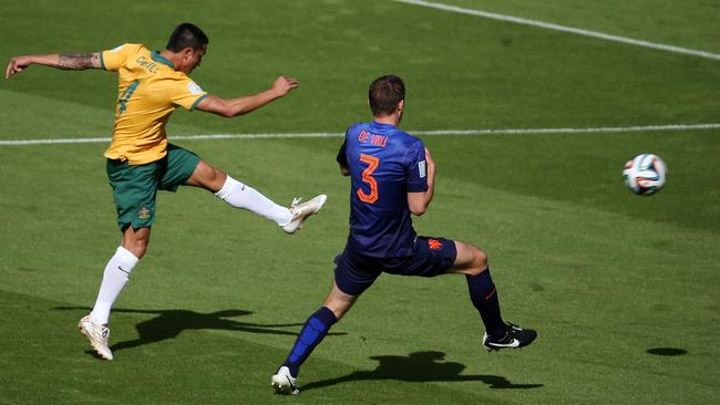 Tim Cahill's epic strike heads towards goal.  <i>Picture: George Salpigtidis</i>