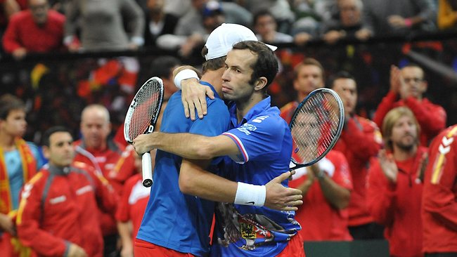 Tomas Berdych (L) celebrates with his Czech Republic teammate Radek Stepanek after beating Spain's Marc Lopez and Marcel Granollers at the Davis Cup final in Prague. Picture: Michal Cizek