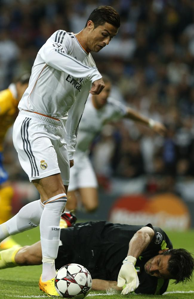 Juventus goalkeeper Gianluigi Buffon gets down against Real Madrid superstar Cristiano Ronaldo.