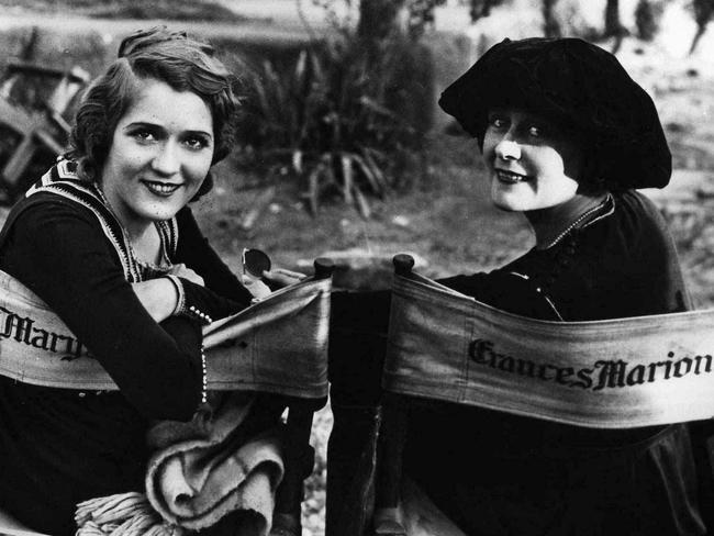 Mary Pickford, left, and director Frances Marion pose together on an early movie set.