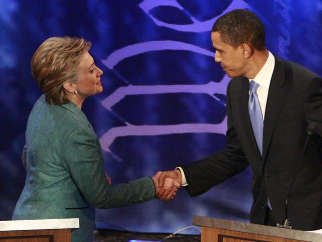 Barack Obama (R) shakes hands with Hillary Clinton during their 2008 race for the White House. Picture: Supplied