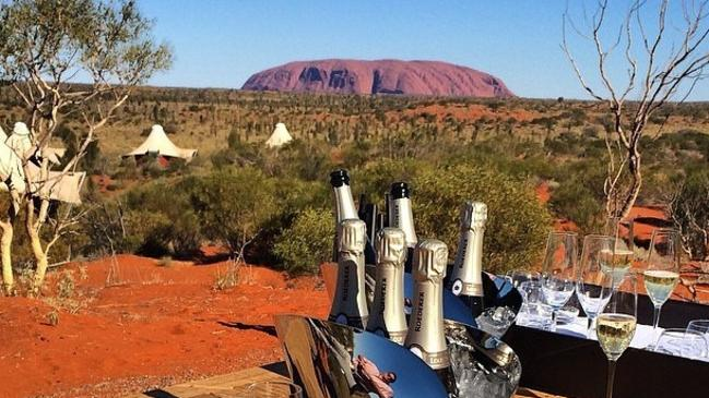 Tourism Australia's Instagram image of canapés and sparkling wine overlooking Uluru received more than 30,000 likes. Pic: Supplied.