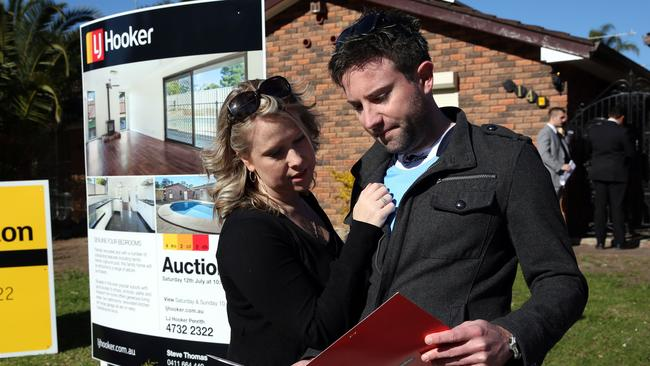 Ben and Chevonne check out a property brochure ahead of yet another auction.