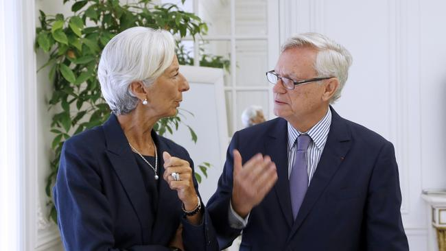 IMF chief Christine Lagarde speaks to her lawyer, Yves Repiquet.