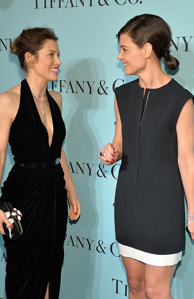 Jessica Biel and Katie Holmes share a laugh. (Photo by Evan Agostini/Invision/AP)