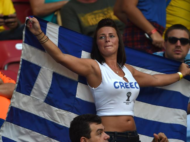 A Greek fan cheers for her team before the start of the round of 16 football match between Costa Rica and Greece at Pernambuco Arena.