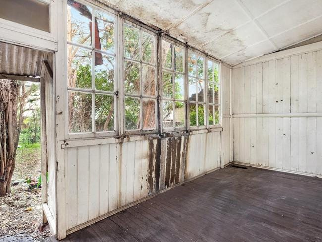 Water damage indicates a leaking roof above this room of the Federation-style Homebush house. Picture: realestate.com.au.