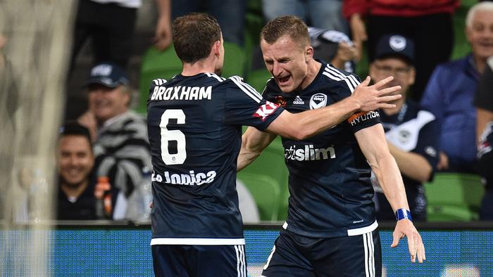 Melbourne Victory players Leigh Broxham (left) and Besart Berisha react after Berisha scored a goal during the round 9 A-League match between Melbourne Victory and Perth Glory at AAMI Stadium in Melbourne, Friday, Dec. 2, 2016. (AAP Image/Julian Smith) NO ARCHIVING, EDITORIAL ONLY