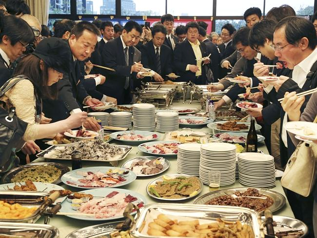 Still on the menu ... supporters of Japan's whaling eat whale meat dishes during a tastin
