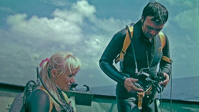 Valerie and Ron Taylor preparing to dive during filming of their film 'Blue Water White Death' near the coast of Durban, South Africa, in 1969. Picture: Films Cinema Centre