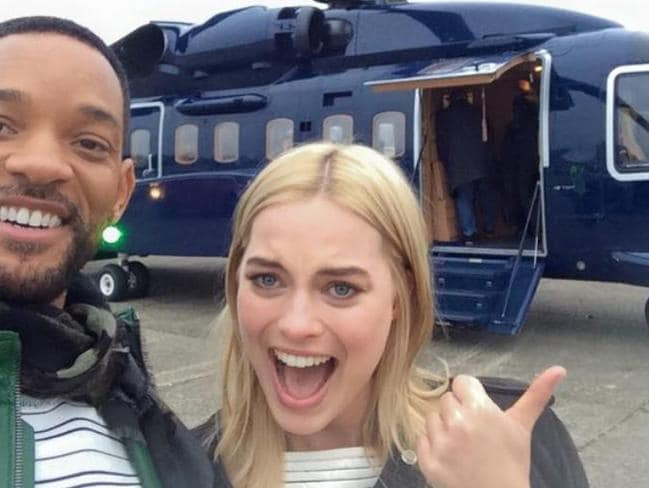 Having fun ... Margot Robbie with Will Smith, about to board a chopper following the London premiere of their film Focus. Picture: Facebook / Will Smith