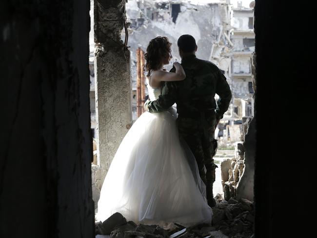 Happy ... Newly-wed Syrian couple Nada Merhi and Hassan Youssef. Picture: AFP/Joseph Eid