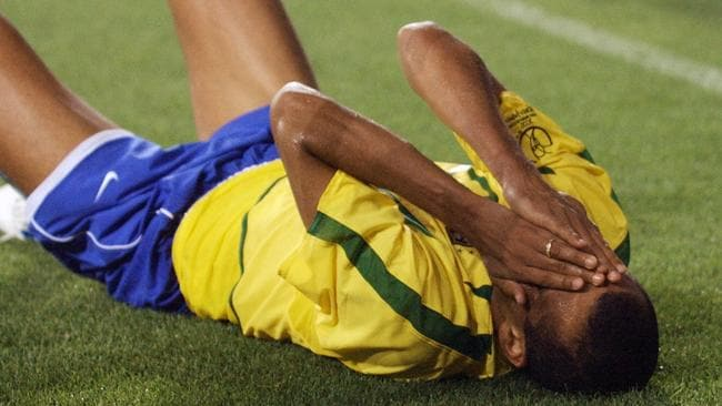 Rivaldo holding head after being hit in the leg during the 2002 World Cup.