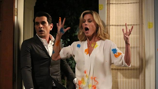 """Ty Burrell and Julie Bowen play husband and wife in """"Modern Family""""."""