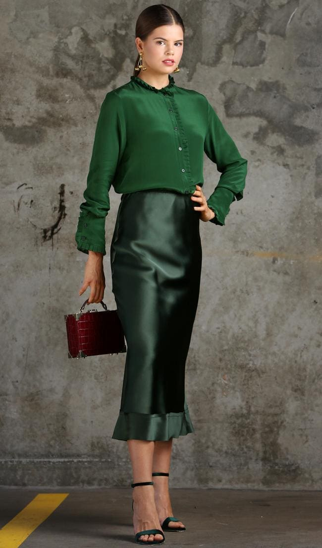 Lee Mathews Silk Shirt ($349), Lee Mathews Silk Satin Skirt ($330), Aspinal of London Trunk Clutch Mini Bag ($899), Tony Bianco Forest Velvet Heels ($179.95), Brisbane Designer Katheleen Kedwell No.9 Gold earrings ($180.00, available online). Model: Frankie Collard. Stylist: Sarah Elizabeth Turner. Photographer: Steve Pohlner/AAP. All clothing provided by David Jones James St <br />