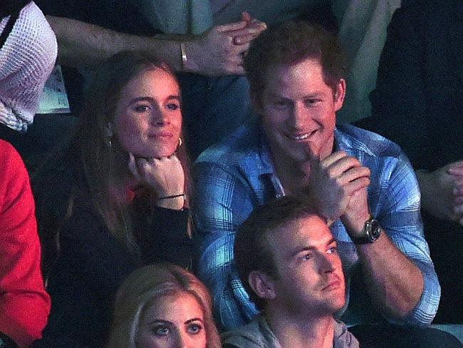 Well matched ... Prince Harry and girlfriend Cressida Bonas in the stands at Wembley Aren
