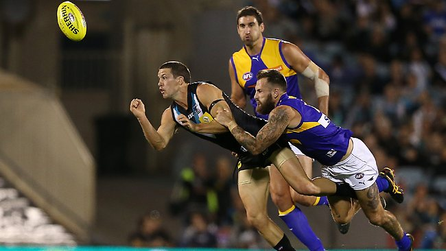 Travis Boak just gets his handpass away from Chris Masten. Picture: Reed Sarah
