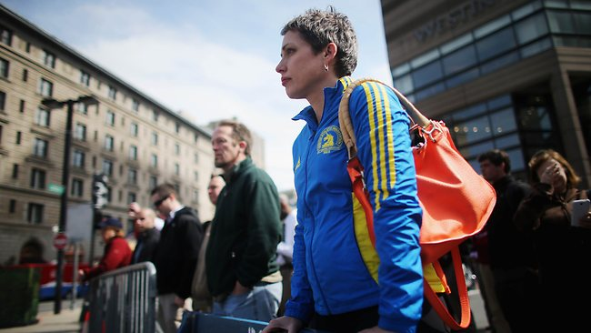 """BOSTON, MA - APRIL 22: Dr. Robin Travers, who finished the 2013 marathon and subsequently heard the explosions, stands in her marathon jacket during a moment of silence honoring the Boston Marathon bombing victims in Copley Square, near the bombing sites, on April 22, 2013 in Boston, Massachusetts. Travers said she would run again in the race and stated, """"I love this race and what it says about the city of Boston."""" Massachusetts Gov. Deval Patrick asked residents to observe a moment of silence at the time of the first explosion at 2:50 p.m. this afternoon, the same day suspect Dzhokhar Tsarnae was charged with using a weapon of mass destruction. Mario Tama/Getty Images/AFP== FOR NEWSPAPERS, INTERNET, TELCOS & TELEVISION USE ONLY =="""
